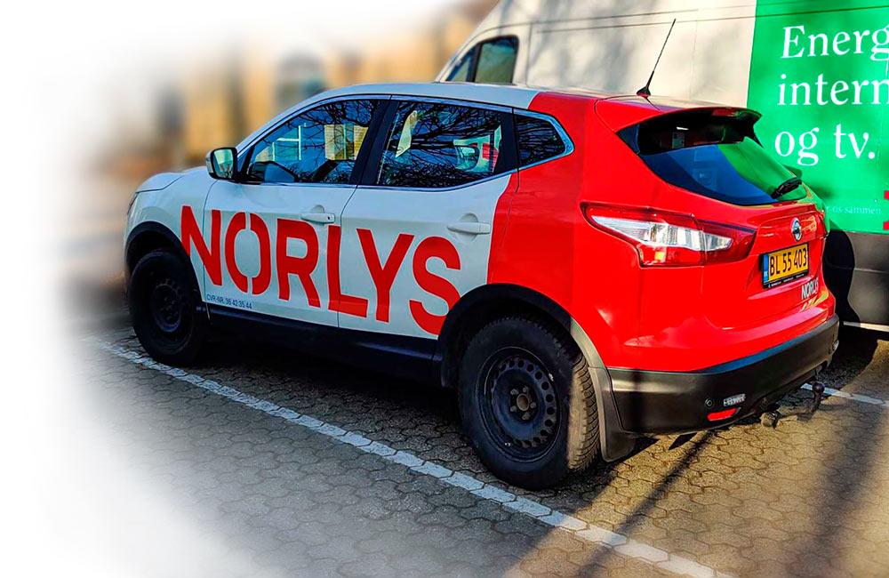 Bilreklame på Norlys-vogn Ford Max